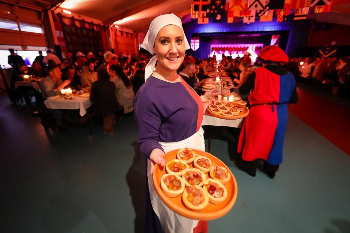 Volunteer serving food