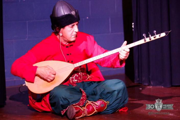 Zafer playing Turkish intrument