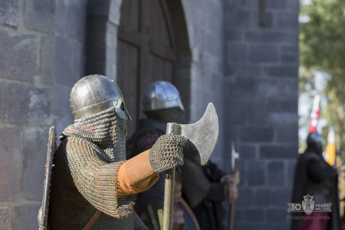 Re-enactors in viking chain maille guarding the castle